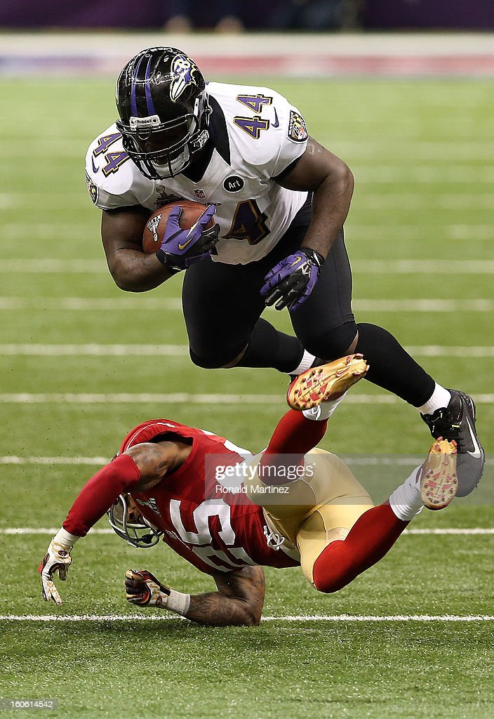 Vonta Leach #44 of the Baltimore Ravens runs with the ball as he attempts to avoid a tackle by Tarell Brown #25 of the San Francisco 49ers during the first half Super Bowl XLVII at the Mercedes-Benz Superdome on February 3, 2013 in New Orleans, Louisiana.