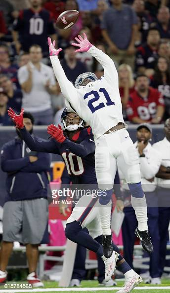 Vontae Davis of the Indianapolis Colts defends a pass attempt intended for DeAndre Hopkins of the Houston Texans in the fourth quarter during the NFL...
