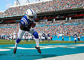 Vontae Davis of the Indianapolis Colts intercepts the ball in the endzone during the first quarter of the game against the Miami Dolphins at Sun Life...