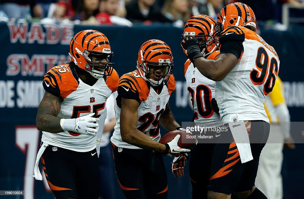 Vontaze Burfict #55, Leon Hall #29, Reggie Nelson #20 and Carlos Dunlap #96 of the Cincinnati Bengals celebrate after Hall returned an interception 21-yards for a touchdown in the first half against the tt during their AFC Wild Card Playoff Game at Reliant Stadium on January 5, 2013 in Houston, Texas.