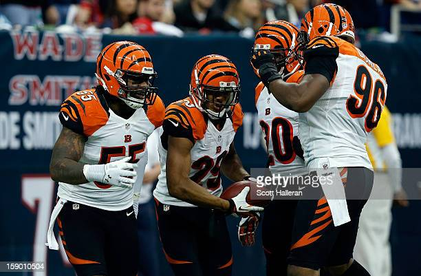 Vontaze Burfict Leon Hall Reggie Nelson and Carlos Dunlap of the Cincinnati Bengals celebrate after Hall returned an interception 21yards for a...