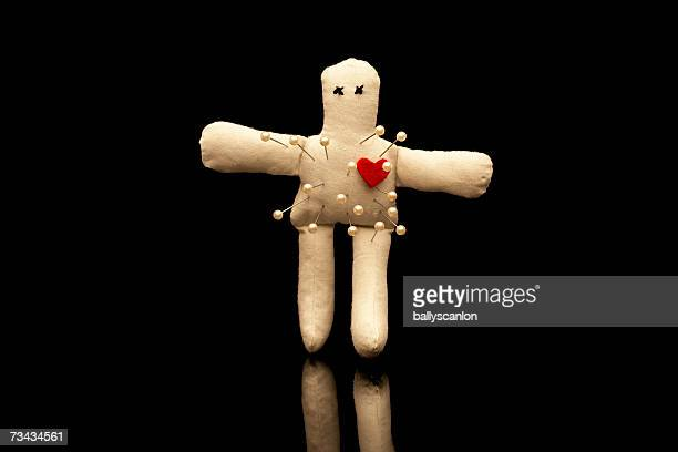 Voodoo doll with straight pins