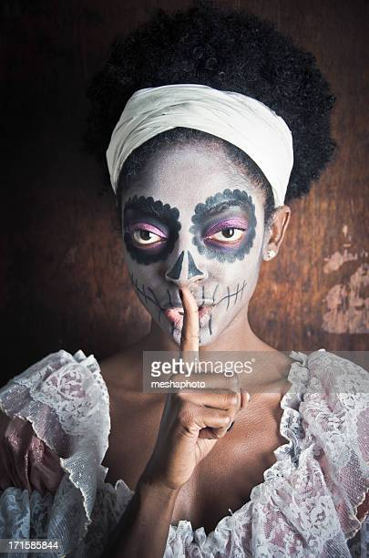 Voodoo Witch With Finger Over Her Lips