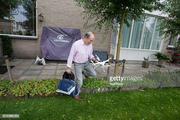 Voorschoten The Netherlands on July 24 2015 A man is seen flying a small drone or quadcopter Anyone wanting to operate a drone needs to have a permit...