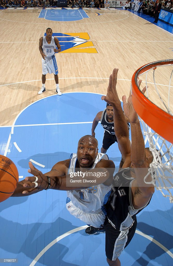 Voshon Lenard #1 of the Denver Nuggets shoots over <a gi-track='captionPersonalityLinkClicked' href=/galleries/search?phrase=Tim+Duncan&family=editorial&specificpeople=201467 ng-click='$event.stopPropagation()'>Tim Duncan</a> #21 of the San Antonio Spurs at the Pepsi Center on October 29, 2003 in Denver, Colorado. The Nuggets won 80-72.