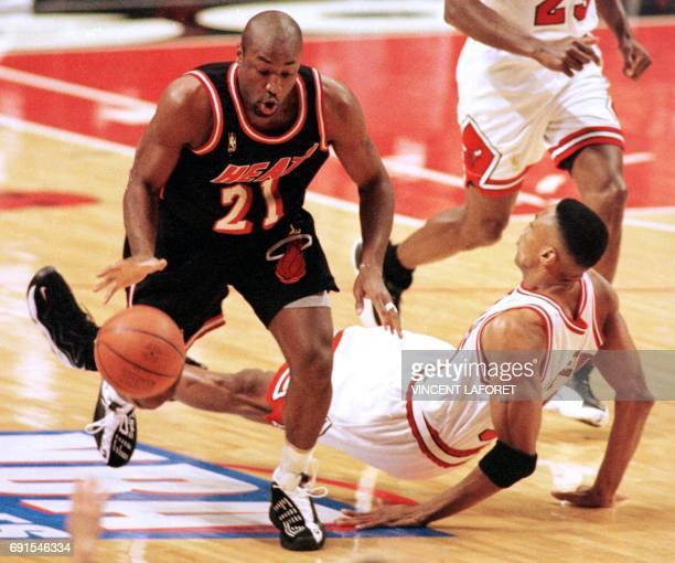 Voshon Lenard of the Miami Heat runs over Scottie Pippen of the Chicago Bulls 22 May during the first half of game two of the NBA Eastern Conference...