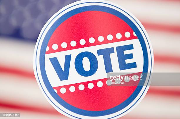 'Vote' button in font of American flag