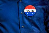 Vote Button on Blue Dress Shirt