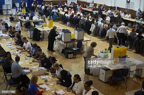 Vote counting staff sort ballot papers at a vote counting centre at The Royal Horticultural Halls in central London on June 23 2016 Voting has ended...