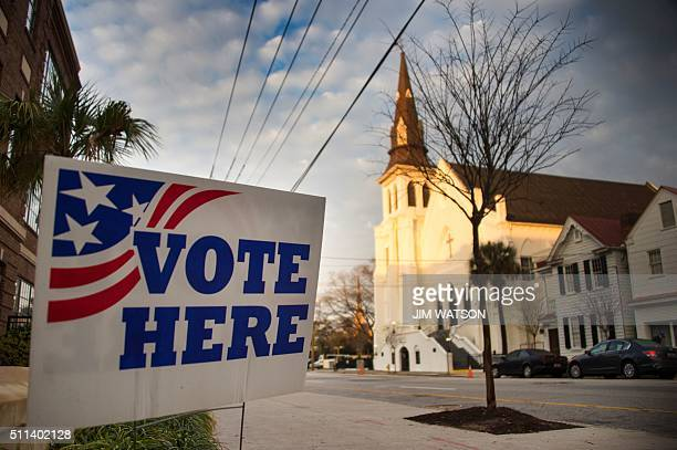 A 'vote here 'sign stands outside a polling station across from the Emanuel African Methodist Episcopal Church in Charleston South Carolina on...
