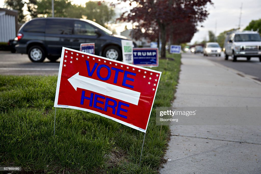 A 'Vote Here' sign stands outside a polling station during the presidential primary vote in South Bend, Indiana, U.S., on Tuesday, May 3, 2016. The outcome in Indiana, where balloting across two time zones will end at 7 p.m. Eastern time, could yield a deciding moment as the presidential race enters the home stretch. Photographer: Daniel Acker/Bloomberg via Getty Images