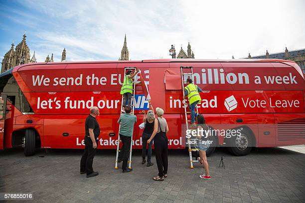 A 'Vote LEAVE' battle bus is rebranded outside the Houses of Parliament in Westminster by the environmental campaign group Greenpeace on July 18 2016...