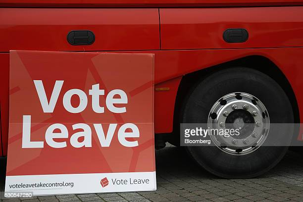A Vote Leave campaign poster rests next to a the Vote Leave Bus during the first day of a nationwide bus tour to campaign for a socalled Brexit in...