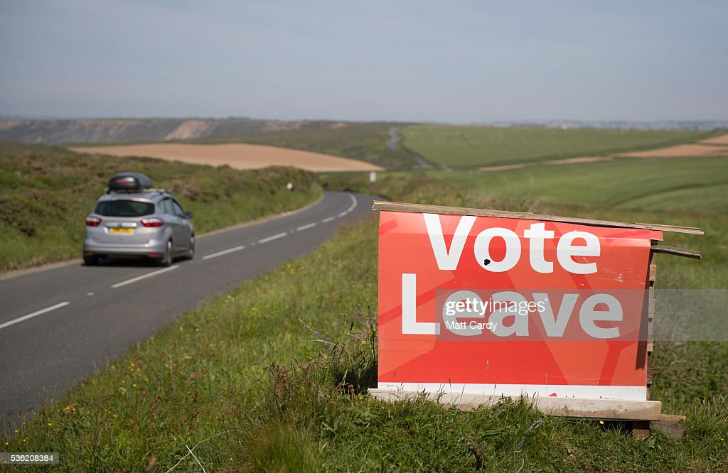 A Vote Leave poster is seen in a field beside a road near Hayle on May 31, 2016 in Cornwall, England. UK voters go to the polls on June 23 to vote in a referendum on the continued membership of the UK in the European Union.