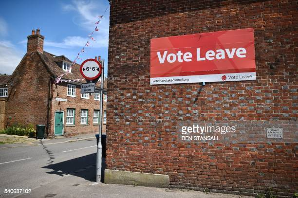 A 'Vote Leave' sign is seen on the side of a building in Charing on June 16 2016 urging people to vote for Brexit in the upcoming EU referendum...