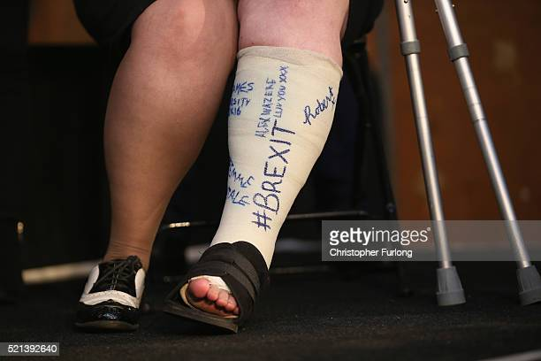 A vote leave supporter has '#BREXIT' written on her plaster cast as she listens to London Mayor Boris Johnson address suporters during a rally for...