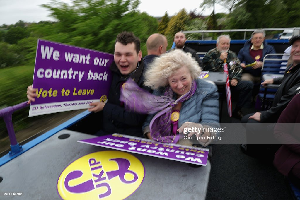Vote Leave supporters battle with the wind as they travel on the battle bus of UKIP leader Nigel Farage during campaigning for votes to leave the European Union on May 25, 2016 near Sheffield, England. Nigel Farage took his battle bus to Chapeltown, near Sheffield, encouraging British people to vote to leave the EU in the June 23rd referendum.