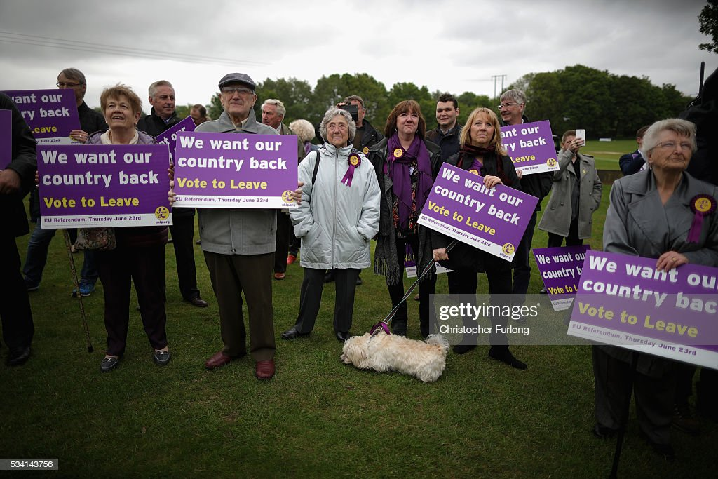Vote Leave supporters listen to UKIP leader Nigel Farage as he campaigns for votes to leave the European Union on May 25, 2016 near Sheffield, England. Nigel Farage took his battle bus to Chapeltown, near Sheffield, encouraging British people to vote to leave the EU in the June 23rd referendum.