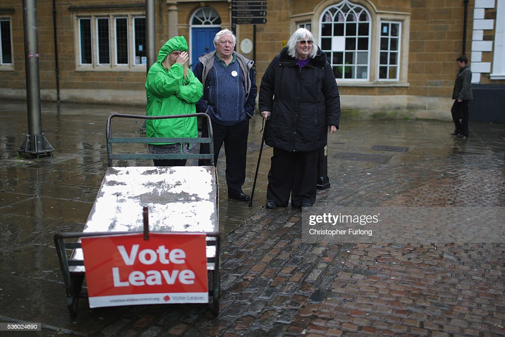 Vote Leave supporters wait in Market Square, Northampton, where UKIP leader Nigel Farage was due to talk to supporters but was cancelled due to safety concerns on May 31, 2016 in Northampton, England. With 23 days to go until the EU referendum Nigel Farage took his battle bus to Birmingham encouraging British people to vote to leave the EU on 23rd June 2016.