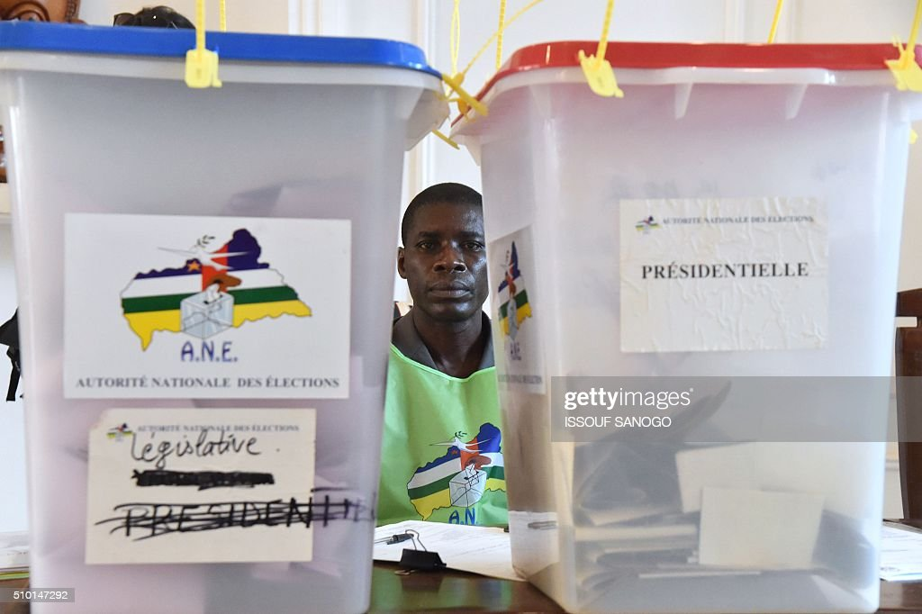 A vote officer sits next to ballot boxes at the polling station at Bangui city hall during Central African Republic second round of the presidential and legislative elections in February 14, 2016. Voters in the Central African Republic began casting ballots on February 14 in delayed legislative elections and a presidential run-off which they hope will bring peace after the country's worst sectarian violence since independence in 1960.The nation, dogged by coups, violence and misrule since winning independence from France, could take a step towards rebirth if the polls go smoothly. / AFP / ISSOUF SANOGO