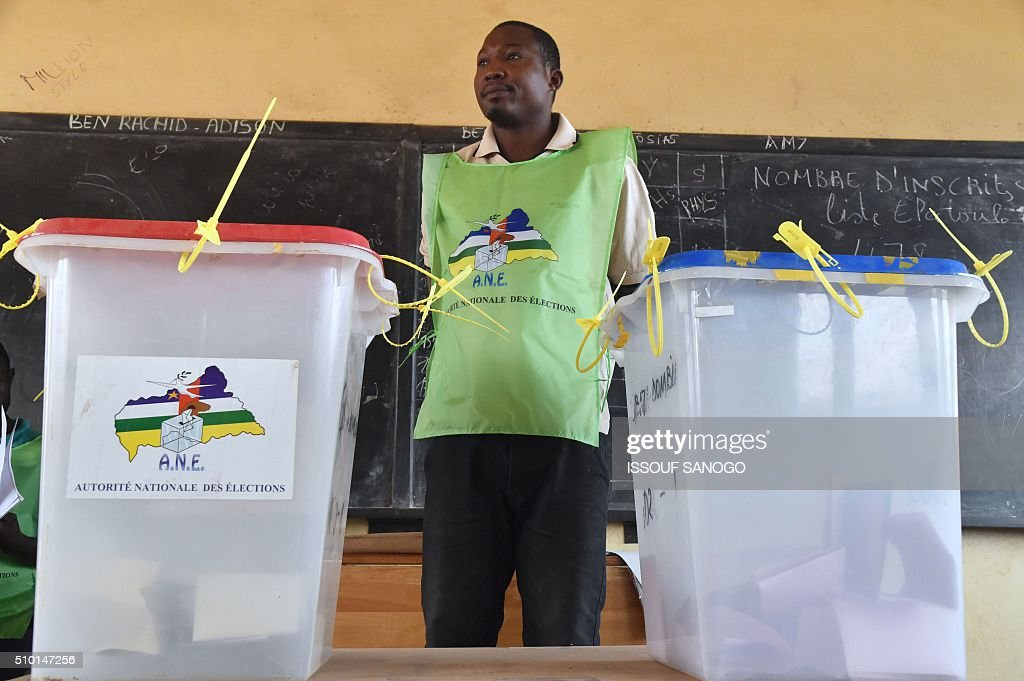 A vote officer stands next to ballot boxes at the polling station in muslim district of PK 5 in Bangui during Central African Republic second round of the presidential and legislative elections in February 14, 2016. Voters in the Central African Republic began casting ballots on February 14 in delayed legislative elections and a presidential run-off which they hope will bring peace after the country's worst sectarian violence since independence in 1960.The nation, dogged by coups, violence and misrule since winning independence from France, could take a step towards rebirth if the polls go smoothly. / AFP / ISSOUF SANOGO