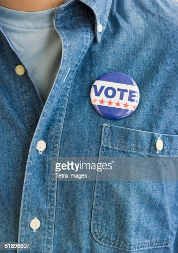 Vote pin on man?s shirt
