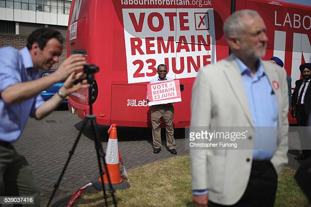 A vote remain supporter looks on as Labour Leader Jeremy Corbyn talks to the media during a visit to the Guru Har Rai Gurdwara Sahib temple on June 9...