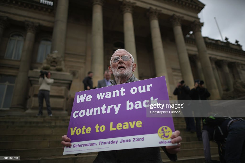 A Vote to Leave campaigner holds a placard as Leader of the United Kingdom Independence Party (UKIP), Nigel Farage campaigns for votes to leave the European Union in the referendum on May 25, 2016 in Bolton, England. Nigel Farage took his battle bus to Bolton encouraging British people to vote to leave the EU on 23rd June 2016.