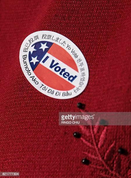 A 'I Voted' sticker appears on a voter's top at a polling station at a fire station in Alhambra California on November 8 2016 / AFP / RINGO CHIU