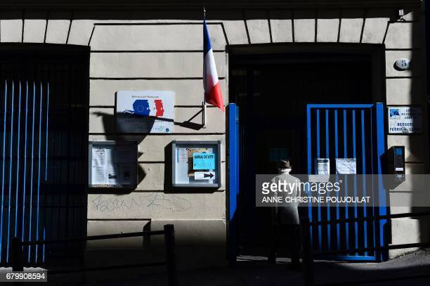 TOPSHOT A voter arrives at a polling station in Marseille southern France on May 7 2017 during the second round of the French presidential election /...