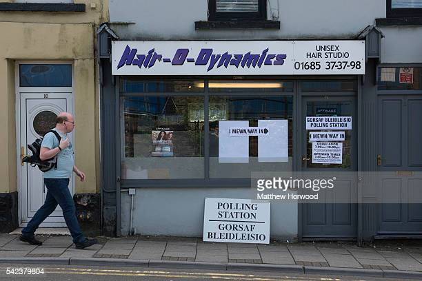 A voter arrives at HairoDynamics hairdressers polling station on June 23 2016 in Merthyr Wales The United Kingdom has gone to the polls to decide...