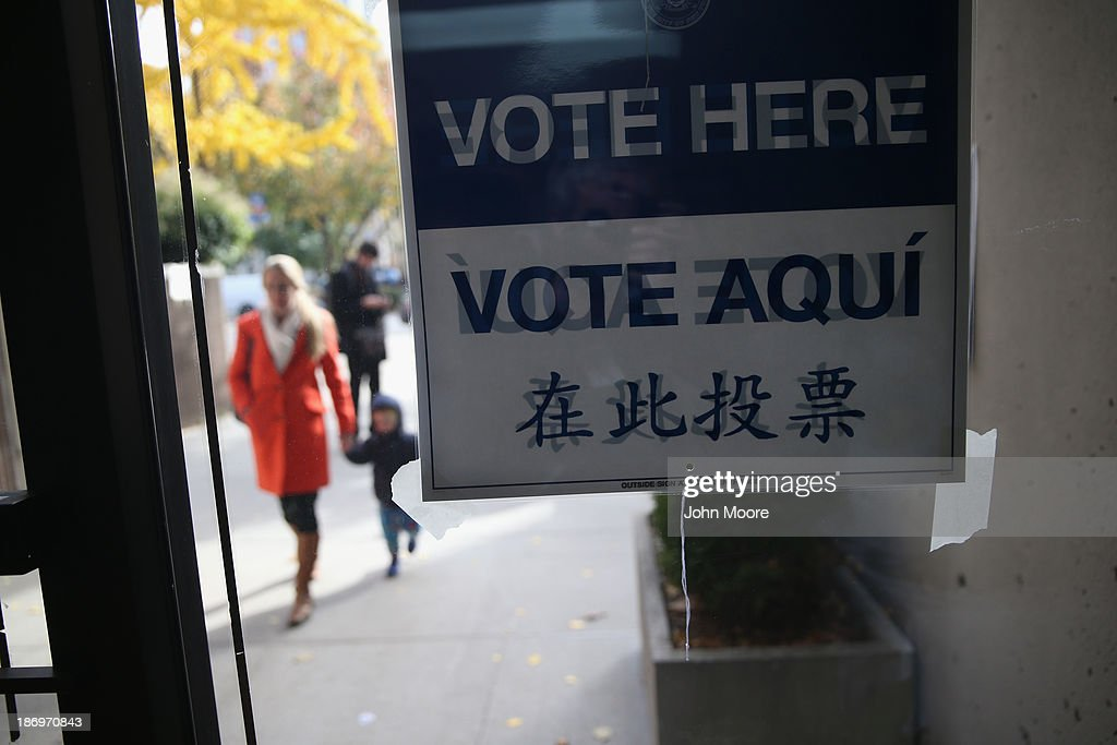 A voter arrives to a polling station on November 5, 2013 in the Brooklyn borough of New York City. New Yorkers went to the polls to choose between Democratic candidate Bill de Blasio and Republican Joe Lhota. De Blasio was widely considered the favorite going into election day.