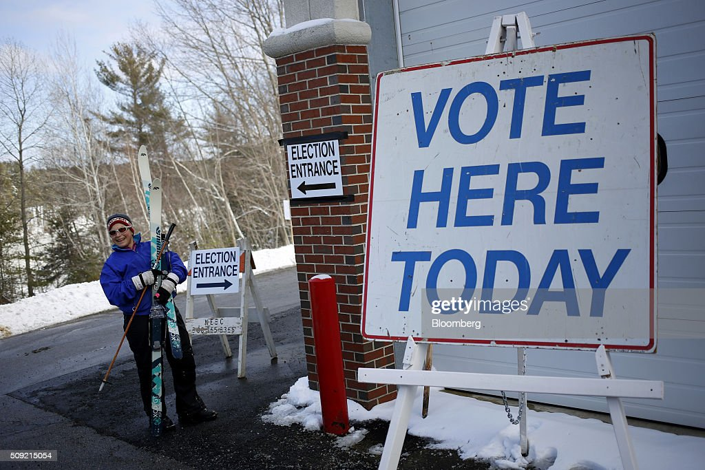 A voter carries a pair of skis outside of a polling station inside the Newmarket Fire Department in Newmarket, New Hampshire, U.S., on Tuesday, Feb. 9, 2016. Voters in New Hampshire took to the polls today in the nation's first primary in the U.S. presidential race. Photographer: Luke Sharrett/Bloomberg via Getty Images