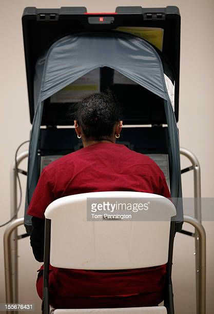 A voter casts an electronic ballot on November 6 2012 in Fort Worth Texas United States Americans across the country participate in election day as...