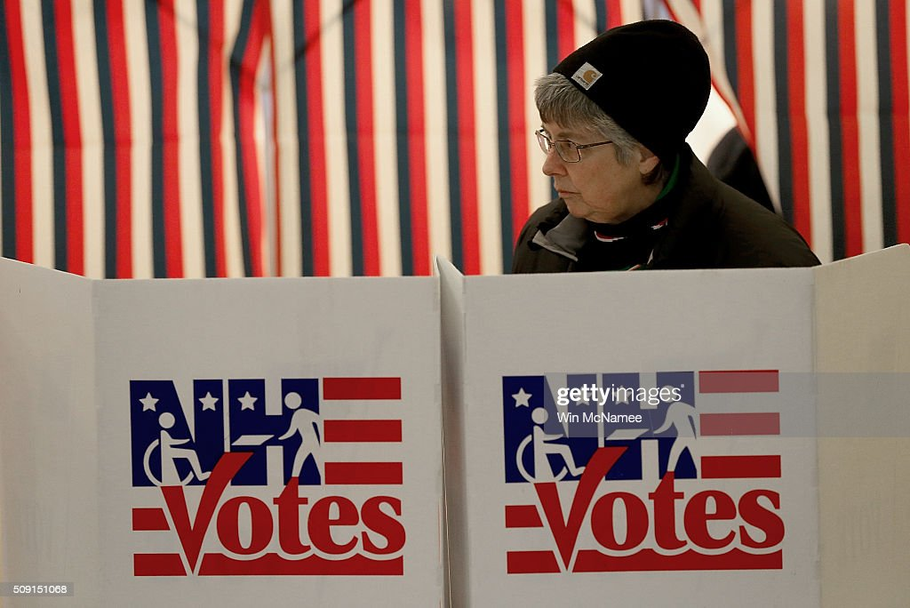 A voter casts her ballot at the Canterbury Town Hall February 9, 2016 in Canterbury, New Hampshire. Voters throughout the state are heading to the polls as the New Hampshire Primary, also known as the first-in-the-nation primary, continues the process of selecting the next president of the United States.