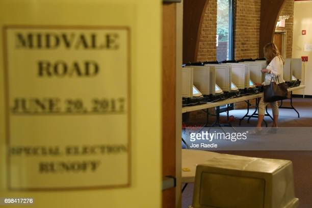 A voter casts her ballot during a special election in Georgia's 6th Congressional District special election at St Bede's Episcopal Church on June 20...