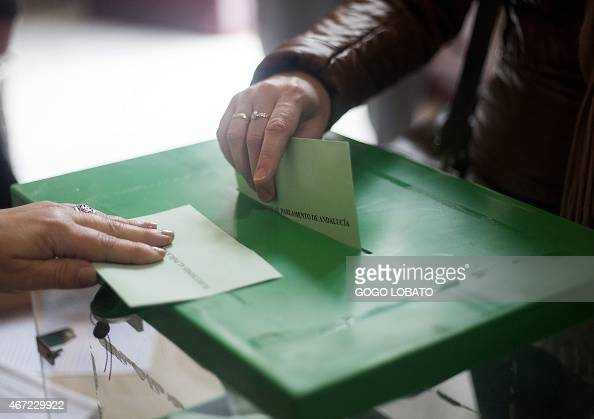 A voter casts her ballot during the regional elections in Cadiz on March 22 2015 Two parties ruling Popular Party and Socialist Party have taken...