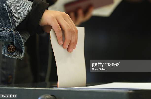 A voter casts her ballot in Berlin state elections on September 18 2016 in Berlin Germany The city of Berlin which is one of Germany's 16 states or...
