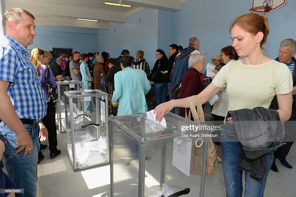 A voter casts her ballot in eastern Ukraine's independence referendum on May 11, 2014 in Slovyansk, Ukraine. The referendum for greater autonomy is being held after pro-Russian activists took over at least ten cities in the eastern part of the country in a bid for less control from the central government from Kiev.