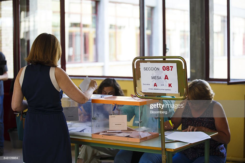 A voter casts her ballot in the Spanish general election in Madrid, Spain, on Sunday, June 26, 2016. Spaniards began voting on Sunday in the second election in six months as the U.K. decision to leave the European Union adds to the uncertainty as the nation seeks to break a political deadlock. Photographer: Angel Navarrete/Bloomberg via Getty Images