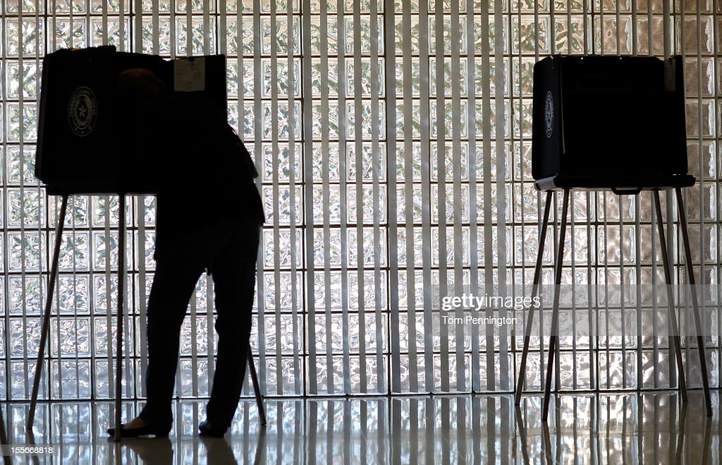 A voter casts her ballot on November 6, 2012 in Mansfield, Texas. Americans across the country participate in Election Day as President Barack Obama and Republican nominee former Massachusetts Gov. Mitt Romney remain in a virtual tie in the national exit polls.
