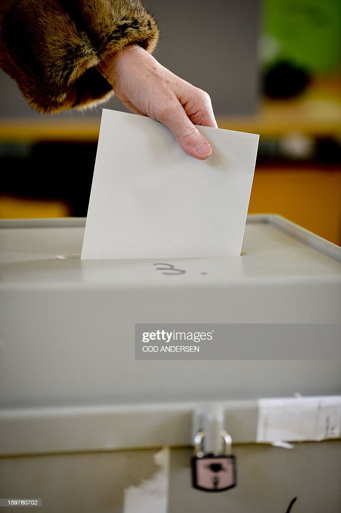 A voter casts his ballot at a polling station at the Friedrich-Dierks Schule in Isernhagen on January 20, 2013 on polling day of the local elections in the central German state of Lower Saxony. The vote is largely seen as a test run for autumn's federal election.