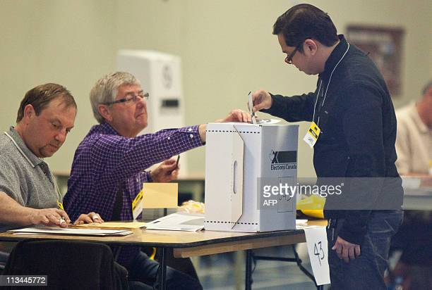 A voter casts his ballot in Canada's federal election at a polling station on May 2 2011 in Calgary Alberta Canada went to the polls Monday with...