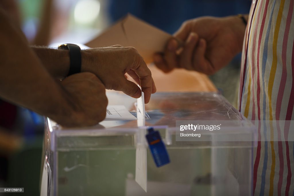 A voter casts his ballot in the Spanish general election in Madrid, Spain, on Sunday, June 26, 2016. Spaniards began voting on Sunday in the second election in six months as the U.K. decision to leave the European Union adds to the uncertainty as the nation seeks to break a political deadlock. Photographer: Angel Navarrete/Bloomberg via Getty Images