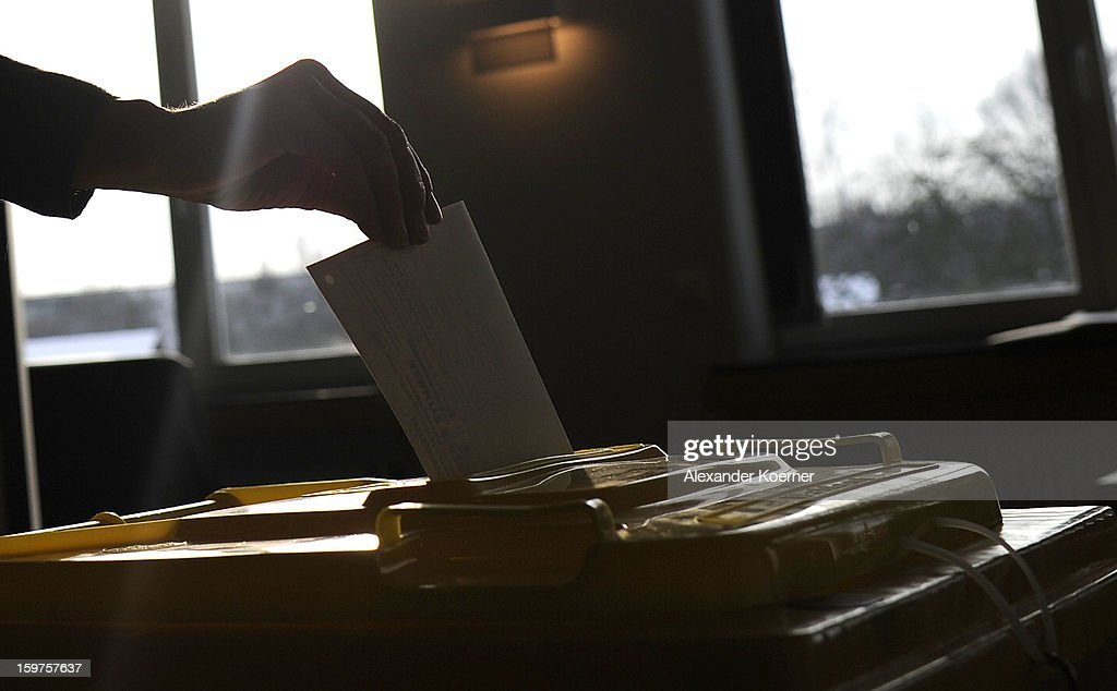 A voter casts their ballot at a polling station as the Lower Saxony eletions get underway on January 20, 2013 in Hanover, Germany. The elections are being seen by many as a strong indicator for the general elections scheduled for later this year.