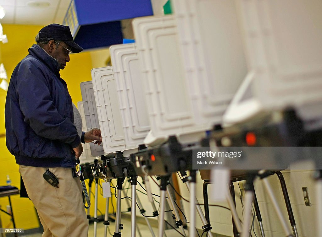 Voter Charles Smallwood stands at a voting booth to cast his ballot at Sunderland Elementary School February 12 2008 in Sunderland Maryland Voters in...