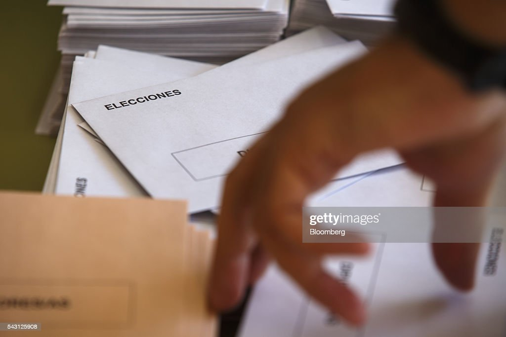 A voter collects an envelope ahead of voting in the Spanish general election in Madrid, Spain, on Sunday, June 26, 2016. Spaniards began voting on Sunday in the second election in six months as the U.K. decision to leave the European Union adds to the uncertainty as the nation seeks to break a political deadlock. Photographer: Angel Navarrete/Bloomberg via Getty Images