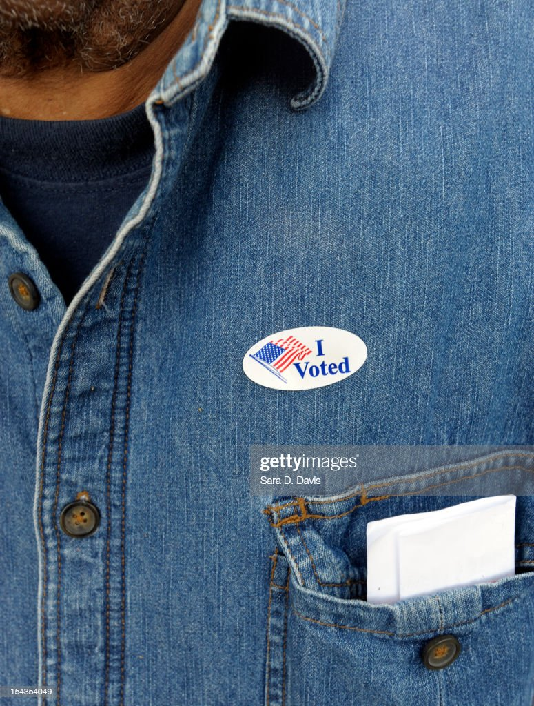A voter displays their 'I Voted' sticker on their shirt after voting on the first day of Early Voting on October 18, 2012 in Wilson, North Carolina. Early Voting is offered at select location from now through November 3 in North Carolina.