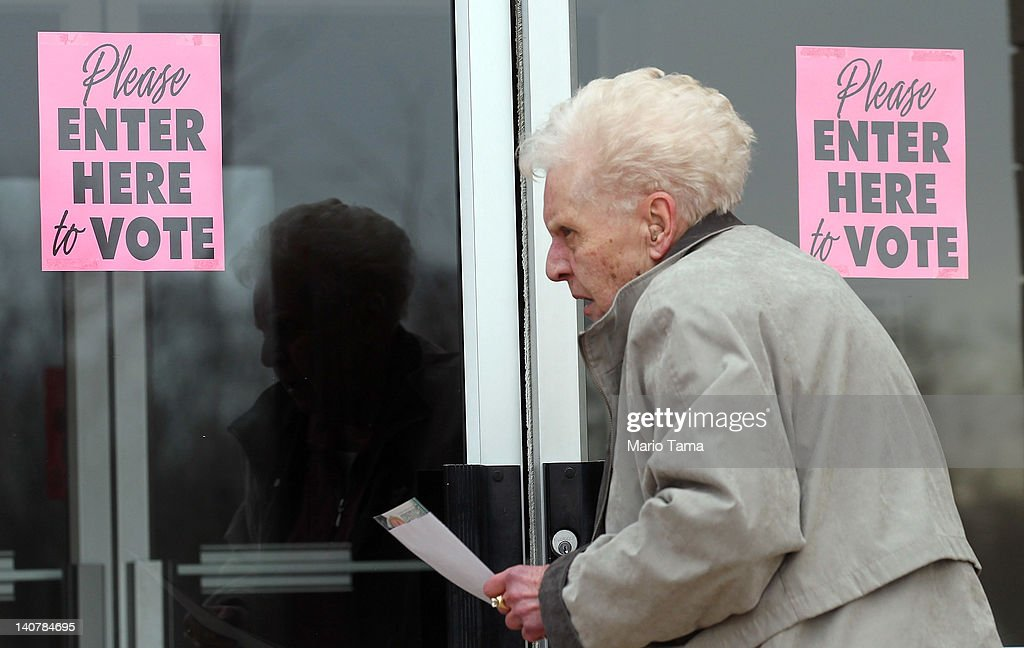 A voter enters a polling place during Super Tuesday voting on March 6, 2012 in Youngstown, Ohio. The two top Republican presidential candidates Mitt Romney and Rick Santorum are running neck and neck in the state.