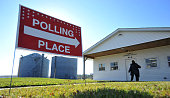 A voter enters a polling station at the Community Center November 4 2014 in Garwin Iowa The Midterm election in Iowa pits Democratic Senate Candidate...